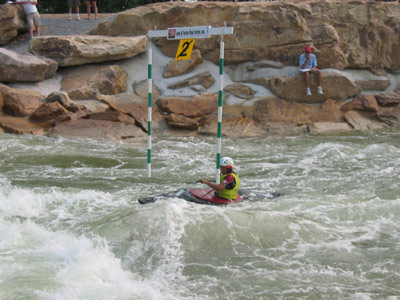 A Woman from the Iranian Team paddles the course